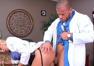 Audrey Show is a blonde that's taking off her uniform before her doctor. This babe is then having her pussy penetrated in the scrutiny room by his dick.