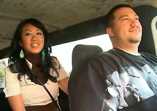 Akira Lei is a ravishing Asian brunette that is caught fucking in the back of a van. She is hungry for rod and the guy that she is with does not frustrate her.