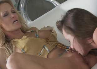MILF golden-haired Jessica Drake and lovely brunette Tori Darksome give each others wet snatch a lick and then share a cock in FFM threesome. They give mouth job together in advance of cock riding