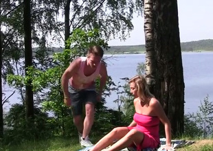 Ardent blond haired MILF lets dude finger her pussy near the river