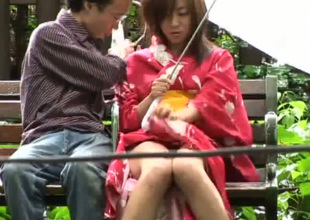 Sitting under umbrella horny Japanese fellow copulates geisha with vibrator