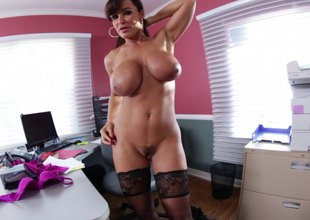 Lisa Ann oils up her large tits and lets him fuck her rack