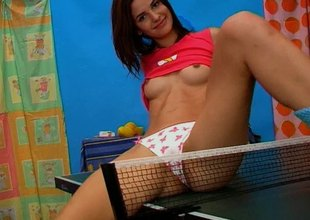 Playful chick goes solo and masturbates passionately on the tennis table
