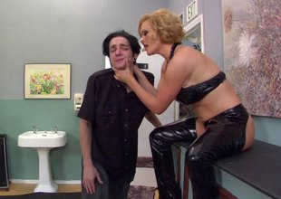 A mistress in leather makes her slave eat her wazoo out