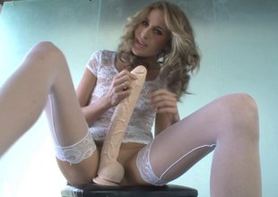 Kara Price sits her slit on a humongous dildo till the edge is only visible