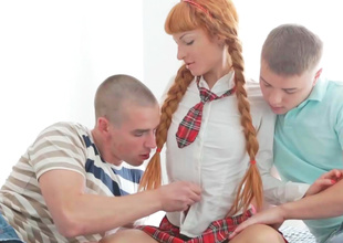 Hot thin redhead is having a threesome with two guys