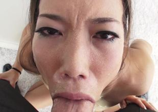 Gorgeous Asian darling sucking a terrific meat pole so well