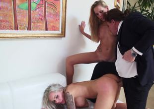 A blonde with some large fake tits is getting fucked in a threesome