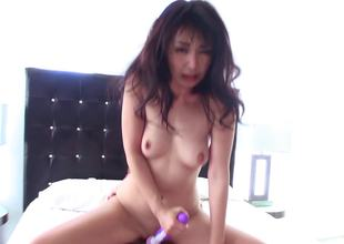 A chick uses a vibrator on her pussy and on a big dick too