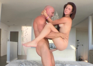 Skinny Kiera sliding on a large cock and taking facial