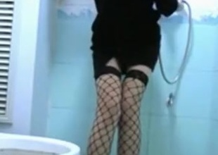 girl in sex underware strips in the bathroom, showers and rubs her trimmed pussy.