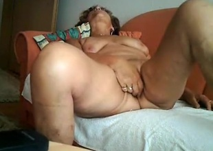 Gilf masturbates with a vibrator and rides older man on the sofa