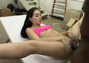 Petite brunette with sexy long legs and small tits surrenders her cunt to a black cock