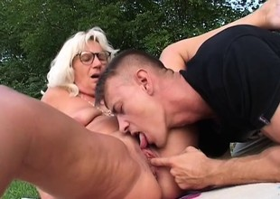 Excited granny is addicted to fucking younger guys with stiff dicks