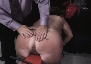 Chunky aged brunette takes some torture on her tits and ass in the dungeon