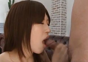 Asian babe swallows this hard cock