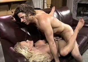 With her sexy feet and her hot lips, a wild blonde gets a big cock ready for action
