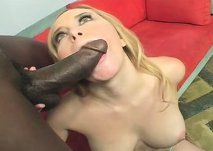 Busty blonde takes every inch of a huge black dick in her cunt and fully enjoys it