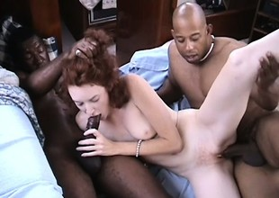 Redhead loves having her pierced pussy fucked by big black cocks