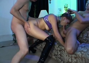 Resigned blonde in darksome leather boots gets fucked hard and deep by 2 guys