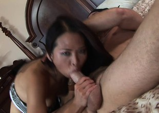Slim Asian babe with a sweet ass Nyomi Zen fucks a big rod on the ottoman