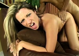 Monstrous dark cock pounding away at Kori's pussy from behind makes her yell