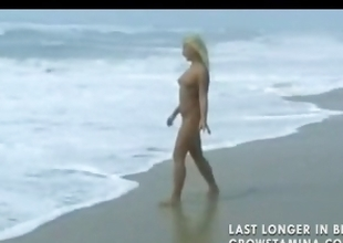 Nude blonde sweetheart walks on the beach and then gets hammered