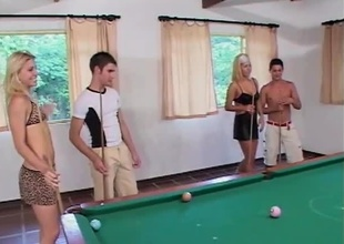These two hawt couples get into some action together. They all get naked and go down on one another. Then one of the girls pulls out a strap-on and fucks the gal while the two guys fuck. They then switch it up and she fucks one of the guys while the other