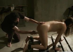 Undressed slave given orgasms by Master on dungeon floor