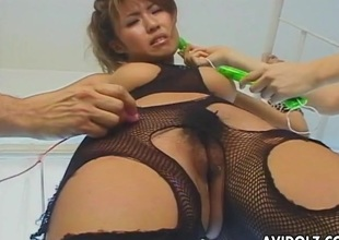 Bound Japanese girl in fishnet lingerie receives vibrated