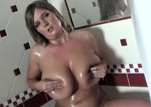 Plump honey gets moist and sexy in the shower