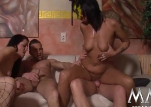 Swingers are stripped and fucking at a hot orgy