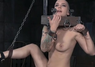 Hairless head babe in kinky bondage