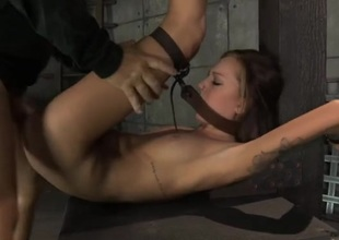 Bound young lady fucked by a pair of males