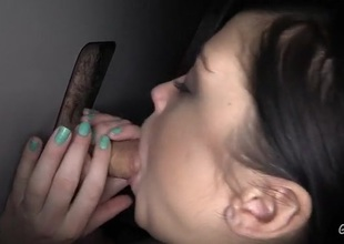 Brunette gloryhole cocksucker swallows cumshots
