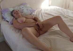Granny invites you into the bedroom to masturbate