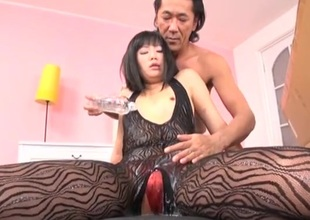 Oriental girl in a body stocking coated in slippery oil