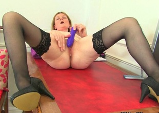 British milf Clare disrobes off her secretary outfit and plays