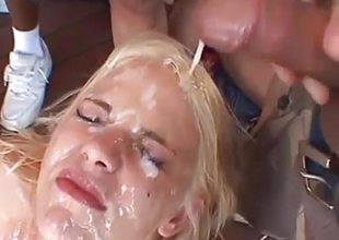 Blonde hottie plastered with cum