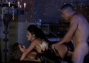 Alektra Blue and Tori Black are in a threesome with a dude in a dungeon that is only lit by candles. They are doing some servitude in this sexy and amazing scene.