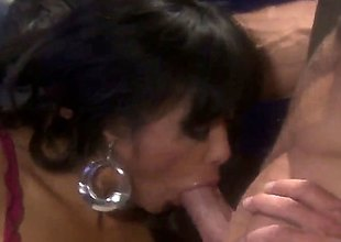 Kaylani Lei is a hawt lady that is giving a blow job. A dick goes deep inside her throat. She is groaning with fun while it is entering her.