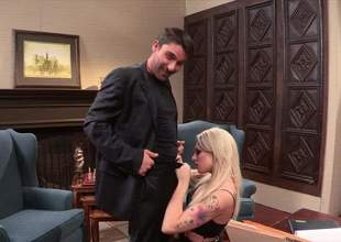 A young blonde in lingerie and black stockings is having some great office sex. That babe makes that long ding strapon really subrigid and then he bonks her up real fucking valuable