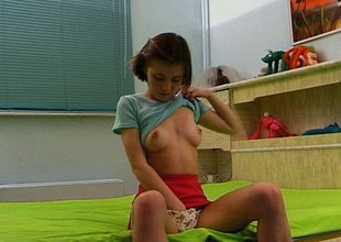 Luminous and cute teen goes solo and masturbates warmly on her bed