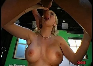 Wild blonde floozy with huge fake tits and a big hot a-hole being fucked long and hard