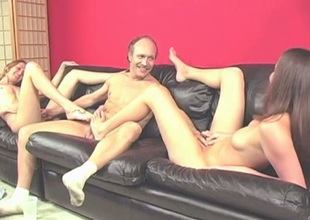 Older dude receives teased with a fine footjob performed by leggy brunette