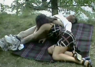 This nasty chick is blowing an old fart's pecker outdoors