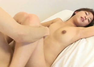 Shaved pussy of quite emotional Japanese bootyful girlie is poked doggy