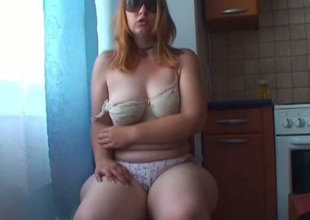 Nasty light haired bitch in sunglasses pets her hungry bushy snatch with toy