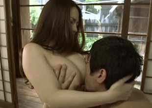 Japanese brunette gets her large milk shakes fondled then screwed from behind
