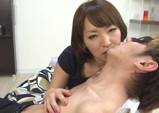 Seductive Japanese girl with natural tits in bra kissing her babes lovely